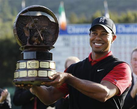 Tiger Woods of the U.S. holds up the trophy after winning the final round of the Chevron World Challenge PGA golf tournament with a birdie on the 18th hole in Thousand Oaks, California
