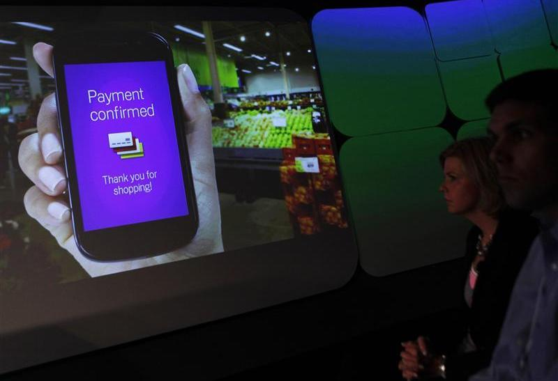 Attendees watch a demonstration of the Google wallet application screen during a news conference unveiling the mobile payment system in New York.