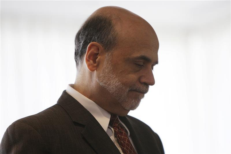 Federal Reserve Chairman Ben Bernanke waits to be introduced at a conference in Washington