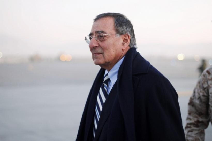 U.S. Defense Secretary Leon Panetta walks across the tarmac upon arrival in Kabul