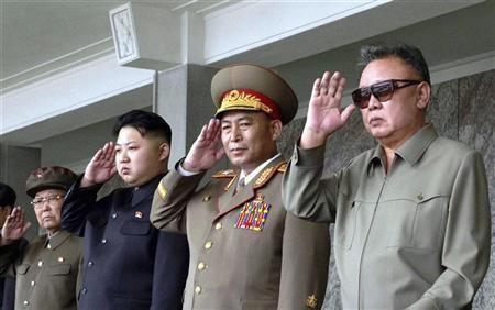North Korean leader Kim Jong-il (R) and his son Kim Jong Un (3rd R) salute as they watch soldiers attending a military parade in the Kim Il Sung square in Pyongyang