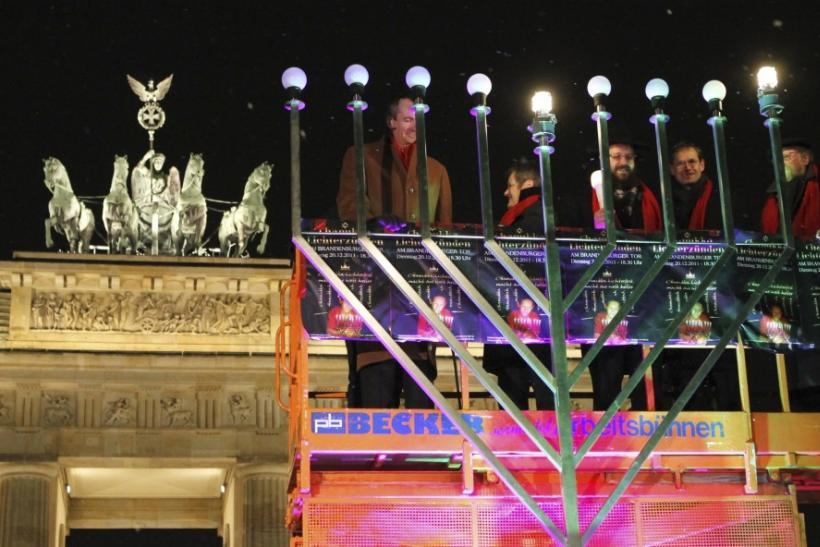 Rabbi Yehuda Teichtal lights a giant menorah during a ceremony in front of the Brandenburg Gate in Berlin