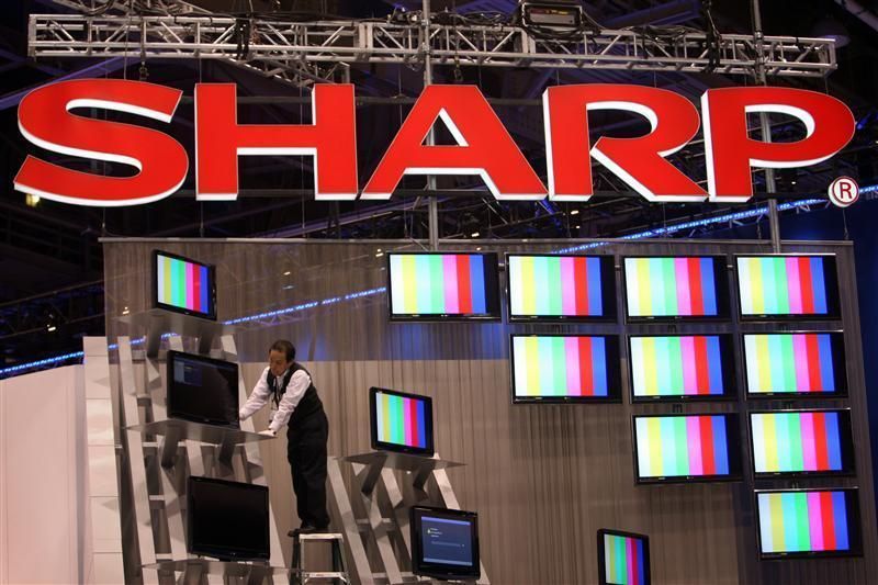 A worker prepares a display of Sharp flat panel televisions for the 2009 International Consumer Electronics Show (CES) at the Las Vegas Convention Center in Las Ve