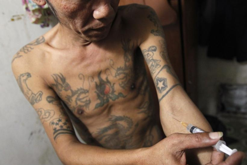 Tuan Anh Nguyen, 45, injects a syringe filled with heroin in his rented room in Hanoi. Researchers at Mexico's National Institute of Psychiatry say they have successfully tested a heroin vaccine on mice and are preparing to test it on humans.