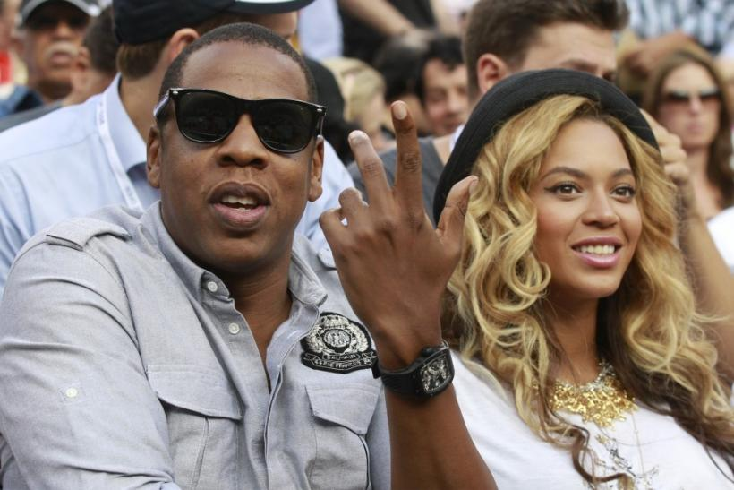 Beyonce Knowles (R) and husband Jay-Z