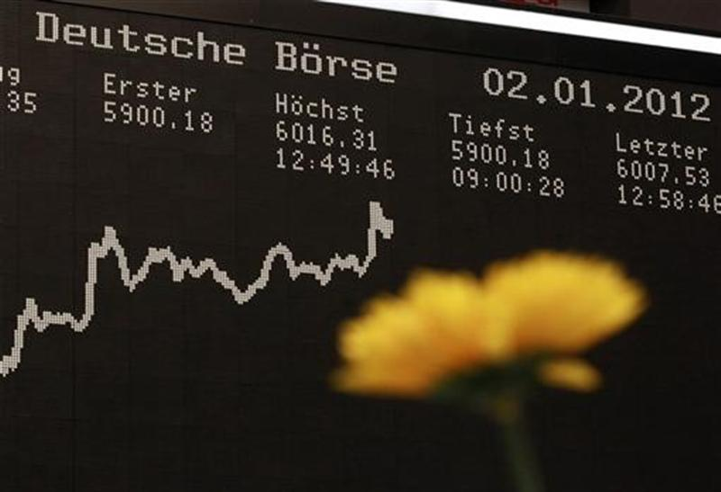 The German DAX Index board is pictured behind a plastic flower during a trading session at the first trading day at Frankfurt's stock exchange in Frankfurt