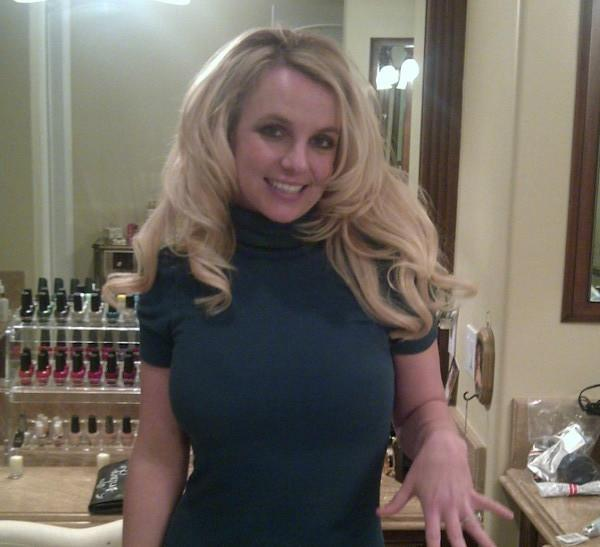 Britney Spears flashes the engagement ring that she received from fiance Jason Trawick, who is due to become her third husband