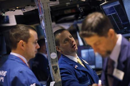 Traders work on the floor of the New York Stock Exchange January 5, 2012.