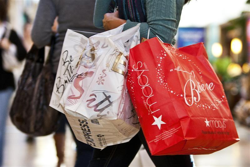 A customer carries shopping bags at South Park mall in Charlotte