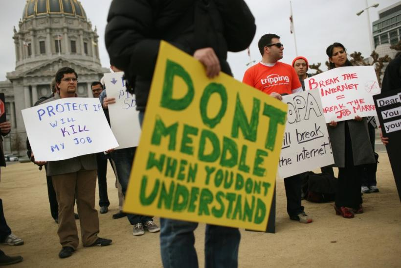 Anti-piracy legislation protesters gather to demonstrate against the SOPA being considered by Congress, at City Hall in San Francisco