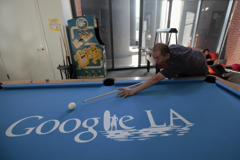 An employee plays pool at the Google campus near Venice Beach, in Los Angeles,