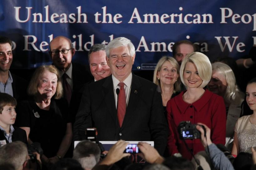 Republican U.S. presidential candidate and former House Speaker Newt Gingrich with wife Callista (R)