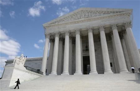 Security guards walk the steps of the Supreme Court in Washington, October 1, 2010.