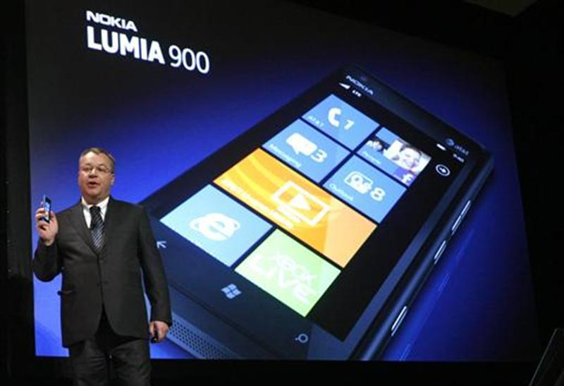 Nokia CEO Stephen Elop displays the Nokia Lumia 900 smartphone at the Consumer Electronics Show opening in Las Vegas