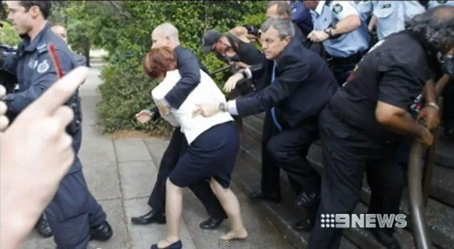 Australian PM Julia Gillard Attacked by Angry Protesters, Dragged to Safety by Bodyguard