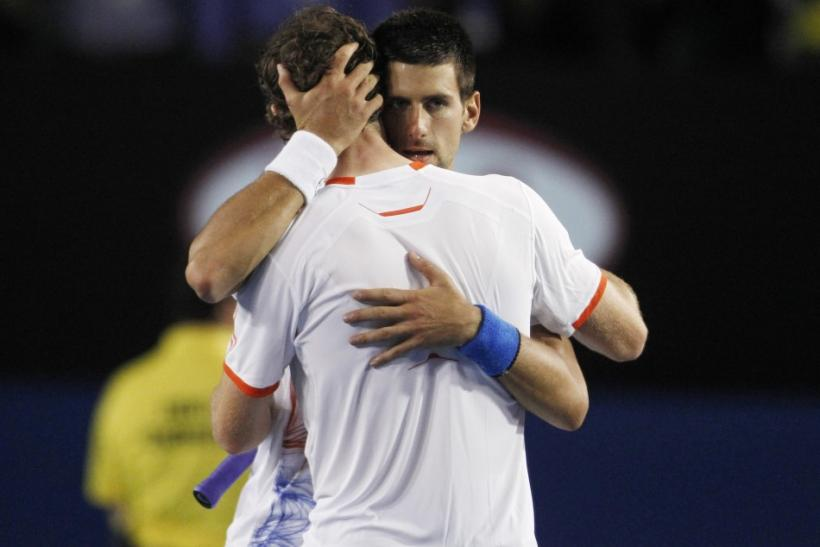 Novak Djokovic embraces Andy Murray