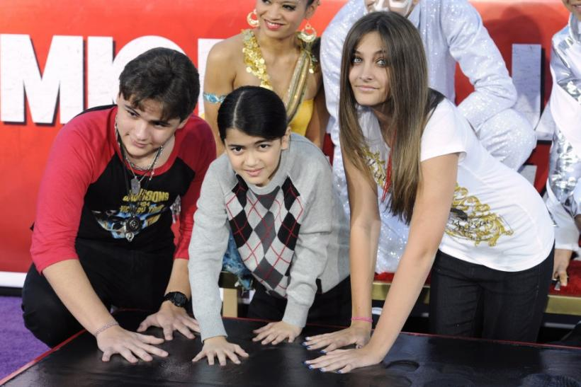 Singer Michael Jackson is immortalized in a ceremony where his children (L-R) Prince, Blanket and Paris use Jackson's shoes and gloves and their own hands to make imprints in cement in the courtyard of Hollywood's Grauman's Chinese Theatre