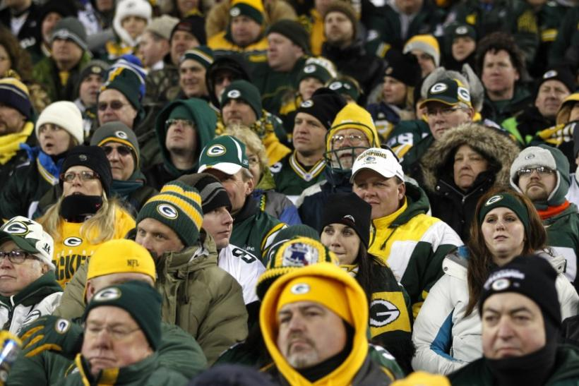 Dejected Green Bay Packers fans watch the final minutes of their game against the New York Giants in their NFL NFC Divisional playoff football game in Green Bay