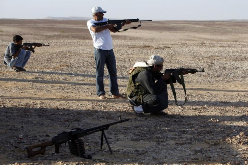 Bedouins test weapons in mountainous region of central Sinai