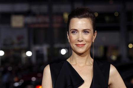 Cast member Kristen Wiig poses at the premiere of ''Paul'' at the Grauman's Chinese theatre in Hollywood, California
