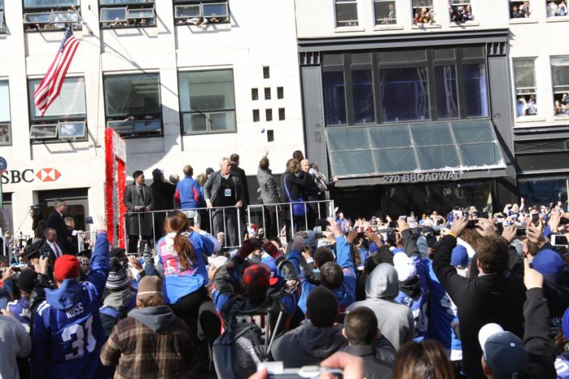 Eli Manning and Justin Tuck spoke to fans as the parade moved to City Hall.