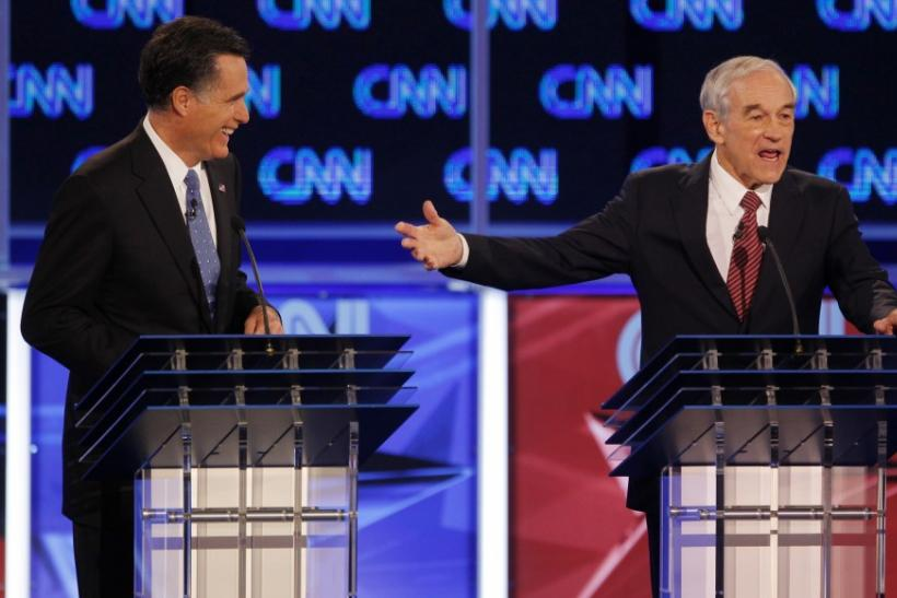 Republican presidential candidate U.S Representative Ron Paul (R-TX)  and former Massachusetts Governor Mitt Romney (L)