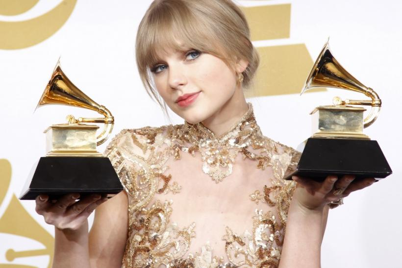"Singer Taylor Swift holds her Grammys for Best Country Song and Best Country Solo Performance (""Mean"") at the 54th annual Grammy Awards in Los Angeles, California"