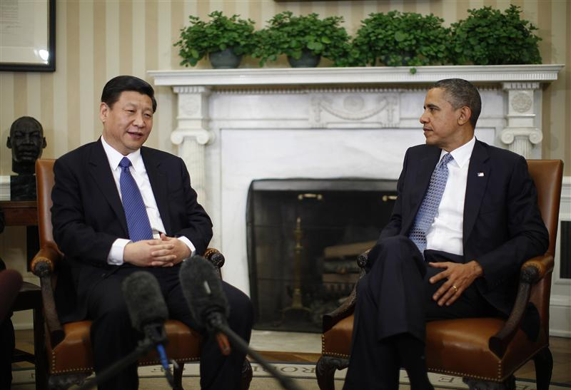 U.S. President Barack Obama listens to China's Vice President Xi Jinping during their meeting in Washington