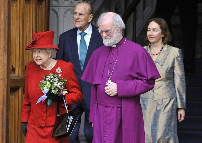 Britain's Queen Elizabeth (L), departs Lambeth Palace with Prince Philip, Archbishop of Canterbury Rowan Williams (2nd R) and his wife Jane (R) in central London February 15, 2012. They were attending a Diamond Jubilee multi-faith reception.