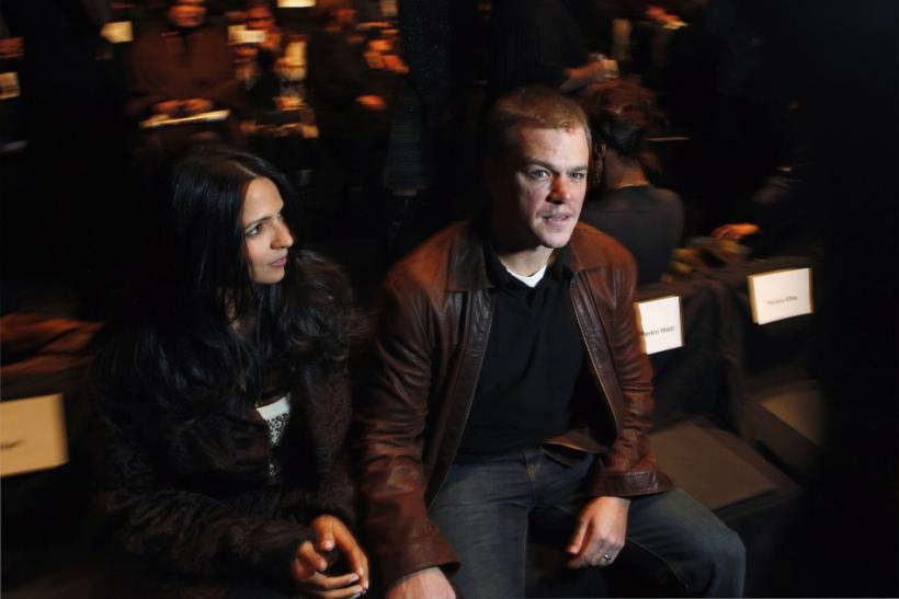 Actor Matt Damon and his wife Luciana Barroso wait for a presentation of the Naeem Khan Fall/Winter 2012 collection during New York Fashion Week, February 14, 2012.