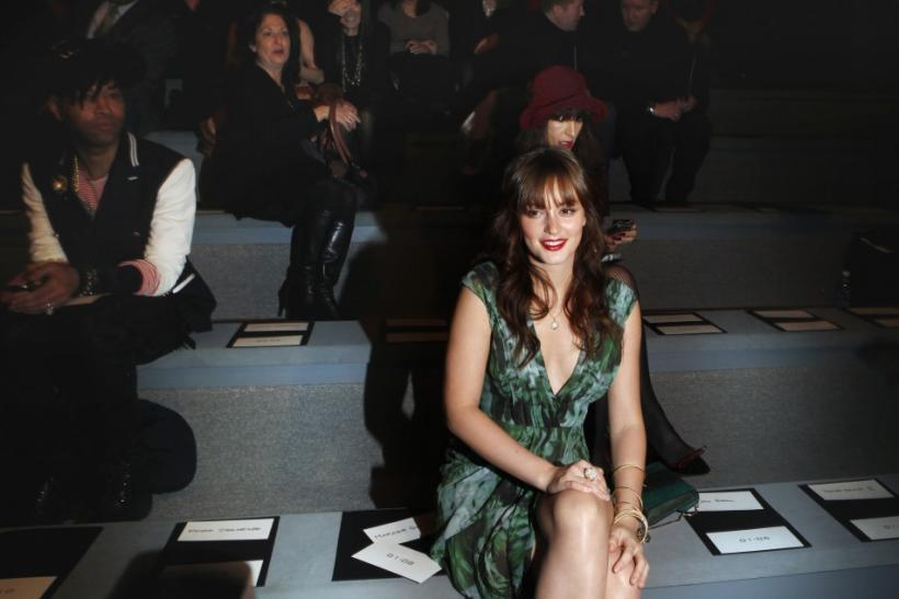 Actress Leighton Meester smiles before a presentation of the Vera Wang Fall/Winter 2012 collection during New York Fashion Week February 14, 2012