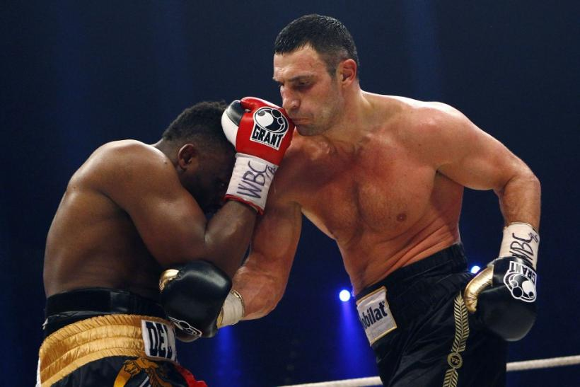 WBC heavyweight boxing champion Vitali Klitschko, right, lands a punch on challenger Dereck Chisora during their title bout in Munich February 18, 2012. Klitschko won the fight after 12 rounds by a 3-0 judge decision.