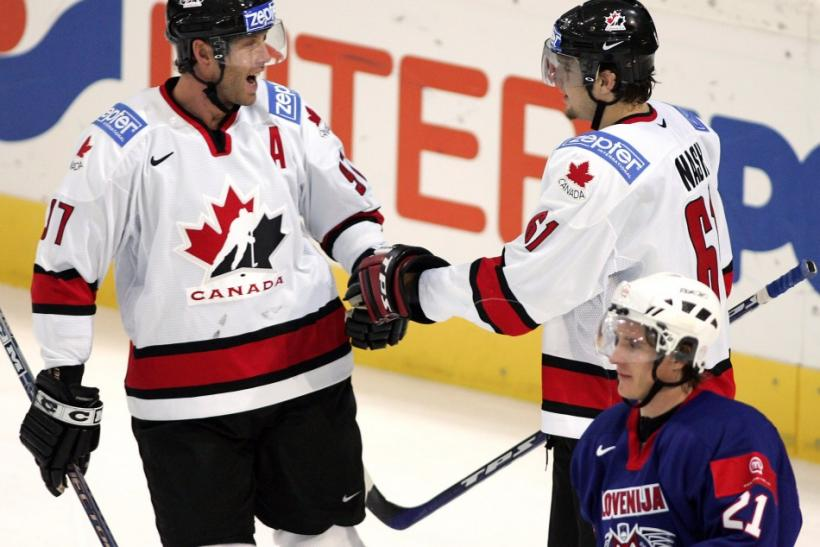 Will this become a familiar sight? Rick Nash and Joe Thornton celebrate a goal for team Canada.