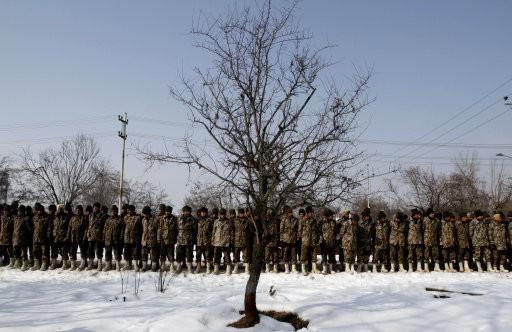 India Border Security Force (BSF) soldiers lined up during a wreath laying ceremony of their colleague, who died after being buried under an avalanche debris, inside their base camp on the outskirts of Srinagar, India, Thursday, Jan 25, 2012. Photo: PA