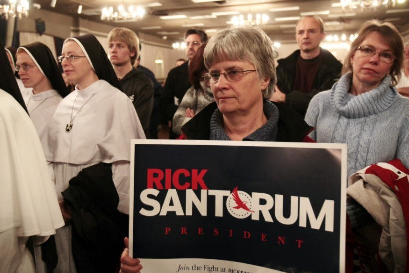 Supporters of U.S. Republican presidential candidate Rick Santorum listen his speech during a campaign stop at a Knights of Columbus hall in Lincoln Park, Michigan February 24, 2012.
