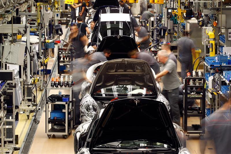 Workers assemble the new Porsche 911 sports car at the Porsche factory in Stuttgart-Zuffenhausen