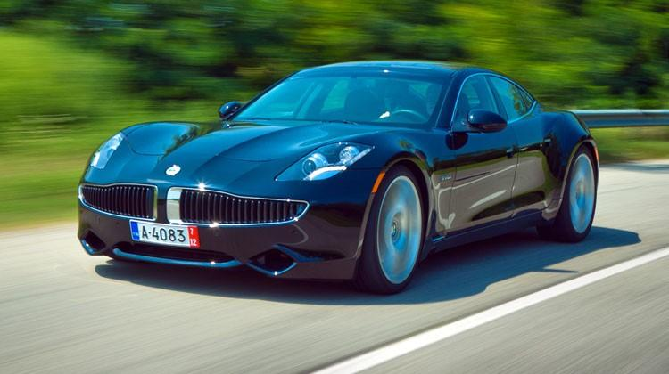 A Fisker Karma drives.