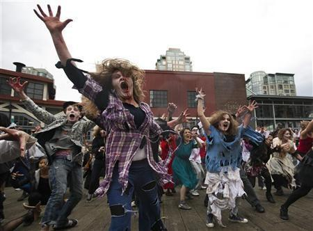 People dressed as Zombies dance to Michael Jackson's ''Thriller'' in downtown Vancouver, British Columbia October 23, 2010.