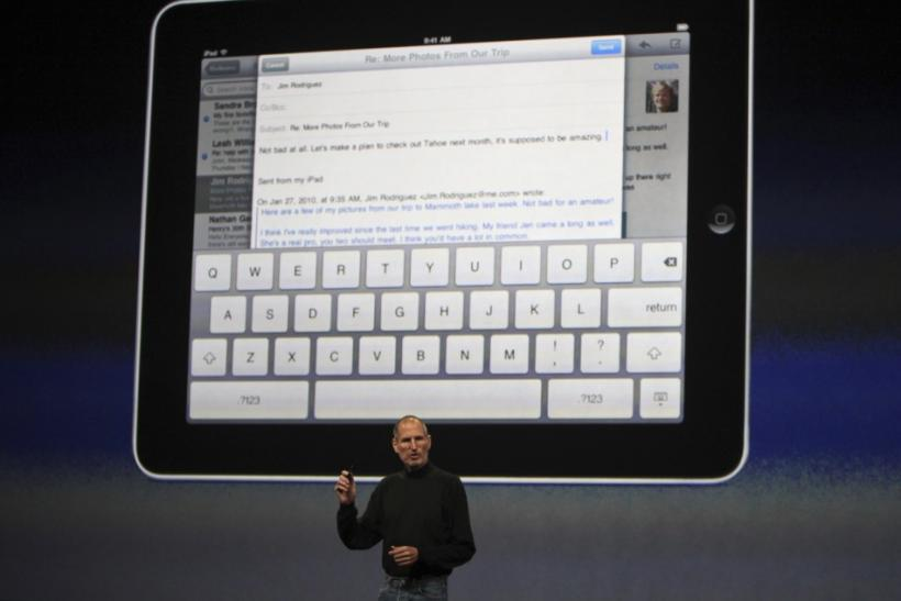 Apple CEO Steve Jobs shows the keypad on iPad tablet during launch in San Francisco