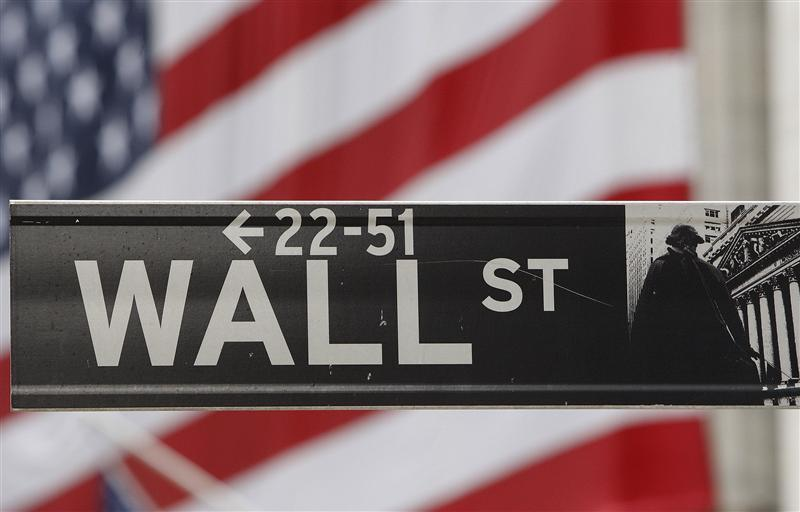 The Wall Street sign is seen in front of the New York Stock Exchange