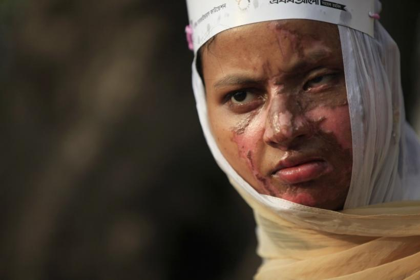 Sultana, a survivor of an acid attack, takes part in an awareness rally about the violence against women as they commemorate International Women's Day in Dhaka