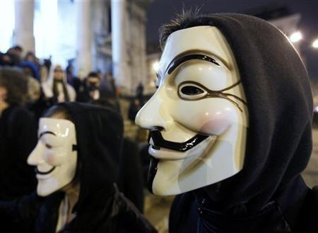 A protester wearing a Guy Fawkes mask, symbolic of the hacktivist group ''Anonymous'', takes part in a protest in central Brussels January 28, 2012.