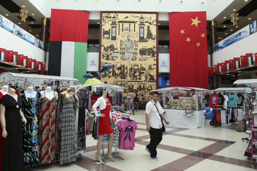 A shopper walks at the Dragonmart mall in Dubai, February 26, 2012.