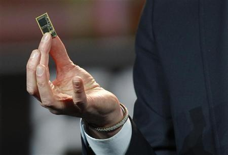 Hans Vestberg, president and chief executive of the Ericsson Group, holds a ST-Ericsson 4G LTE chip during his keynote address at the 2012 International Consumer Electronics Show (CES) in Las Vegas, Nevada, January 11, 2012.