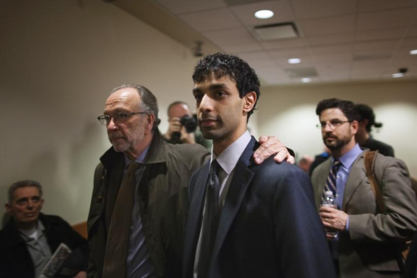 Dharun Ravi (C), a former Rutgers University student charged with bias intimidation, departs the courtroom with lead defense attorney Steven Altman at the Superior Court of New Jersey in Middlesex County, New Brunswick, New Jersey