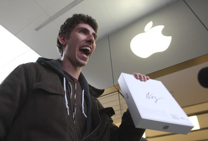 Goran Marberg holds his new iPad, autographed by Apple co-founder Steve Wozniak who, with his wife Janet, waited in line overnight with customers at the Apple Store in Century City Westfield Shopping Mall in Los Angeles, California March 16, 2012.
