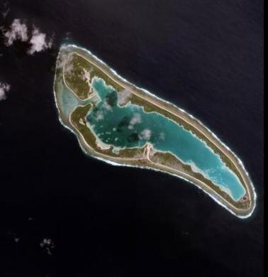 This four-metre resolution image, collected by Space Imaging's IKONOS satellite on April 16, 2001, shows Nikumaroro Island, an uninhabited Pacific coral atoll in the Republic of Kiribati. The atoll is located about 2,000 miles southwest of Hawaii. [R