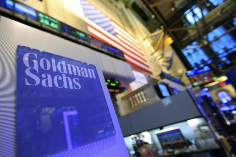 A Goldman Sachs sign is seen on at the company's post on the floor o