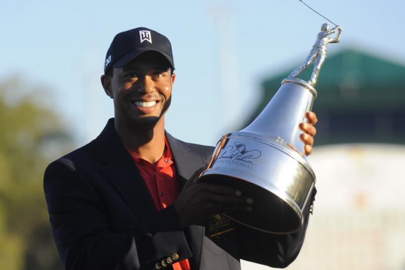 Tiger Woods holds the trophy after winning the Arnold Palmer Invitational PGA golf tournament in Orlando.