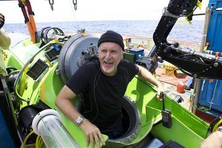 ''Titanic'' film director James Cameron gives two thumbs-up as he emerges from the Deepsea Challenger submersible after his successful solo dive to the deepest-known point on Earth, reaching the bottom of the Pacific Ocean's Maria